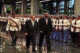 Lesotho King Letsie III during a state visit to the Republic of Cuba. He reviews the honor guard with Cuban President Raul Castro Ruz in November 2011. by Pan-African News Wire File Photos