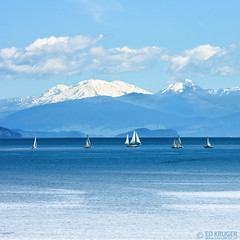 Blue Taupo (Ed Kruger) Tags: morning blue newzealand sky sun lake seascape reflection water sunshine clouds river daylight boat ship yacht horizon sunny vessel nz boating northisland taupo kiwi aotearoa allrightsreserved 2007 admiralty yachting skyphoto shipphoto newzealandphoto taupolake edkruger photoofnewzealand kirillkruger rodkruger photosofthesky