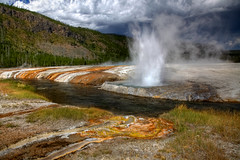 Cliff Geyser (Rozanne Hakala) Tags: park usa mountain tourism water clouds creek landscape outdoors us colorful scenic tourist spray steam unescoworldheritagesite caldera yellowstonenationalpark yellowstone algae wyoming geyser nationalparkservice hotspring dramaticsky bacteria geothermal thermal hdr eruption ynp sprouting erupting sinter wy microorganisms runoff gushing snakeriverplain thermophiles blacksandbasin cliffgeyser bacterialmats greateryellowstoneecosystem ironspringcreek geyserite firstnationalpark yellowstonecaldera yellowstoneplateau rozannehakala