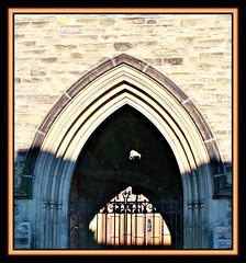 Light & Shadows (bigbrowneyez) Tags: door light sunlight canada macro brick church beautiful metal stone architecture design gate arch shadows bright ottawa shapes entrance symmetry layers welcome ornate depth bronson workmanship lightshadows