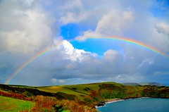 Cornish Rainbow. By R J Watson (Ray~Watson) Tags: blue light sea sky sun colour green yellow clouds landscape nikon cornwall view scene hills