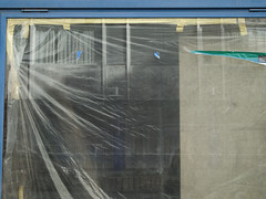 20110929_wien7_0116de (casually, krystina) Tags: urban reflection window shop plastic tape abstraction palimpsest refurbishment