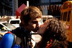 A Kiss @ #OWS (PatMinNYC) Tags: nyc financialdistrict 99 financialcenter lowermanhattan ows zuccottipark patminnyc