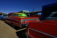 impalas. 2011. (eyetwist) Tags: auto california longexposure orange cinema lightpainting green classic chevrolet abandoned car night vintage dark movie photography nikon desert tripod rusty fullmoon moonlit socal chevy chrome workshop highdesert mojave moonlight yelow junkyard scrapyard nikkor impala recycling derelict gel nocturne arid taillights stunt 1964 strobe mojavedesert deser impalas eyetwist chromeography npy filmcar propcar d7000 capturenx2 eyetwistkevinballuff nikond7000 1024mmf3545g paulsjunkyard