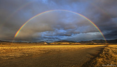 Rainbow Road (Dylan MacMaster) Tags: road clouds rural point rainbow double hills idaho dirt vanishing fotocompetitionfotocompetitionbronze