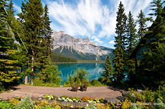 A View to Remember (idashum) Tags: travel flowers cloud mountain lake canada pine clouds garden landscape photography nikon scene pines alberta vista banff relaxation mountainlake ida enjoyment shum yoho banffnationalpark emeraldlake mountainrange canadianrockies d300 yohonationalpark glaciallake wickerchairs idashum idacshum