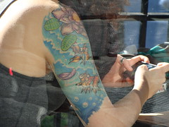 Silliest Tattoo (knightbefore_99) Tags: fish silly mobile tattoo bar vancouver ink sad phone sheep dumb cell lame pathetic eastvan texting