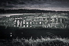 Whale Bones (pretty in pixels) Tags: wood light sunset shadow sky blackandwhite broken water grass vintage boats scotland glasgow 28mm wide wideangle dramaticsky destroyed