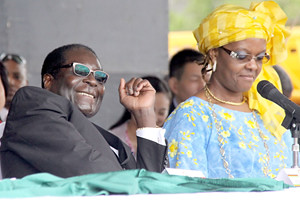 Republic of Zimbabwe President Robert Mugabe with First Lady Amai Grace Mugabe at a public gathering inside the country. Zimbabwe has challenged western imperialism over the land redistribution program. by Pan-African News Wire File Photos