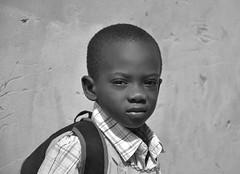écolier de Rufisque (CéCybo) Tags: africa boy portrait blackandwhite bw white black byn blancoynegro blanco monochrome person nikon noir child noiretblanc retrato negro garoto porträt kinder nb kind nome senegal criança portret enfant niño blanc ritratto menino personne ecole junge gens garçon africain afrique schoolchild monochroma sénégal bambino negroyblanco copil nyb sénégalais incoloro băiat écoliers monochromie scharwz d3100 nikond3100