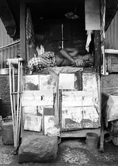 Mumbai, September 1999 (Riverman___) Tags: travel blackandwhite india blancoynegro film 50mm md minolta 28mm 400 bombay hp5 mumbai crutches ilford fp4 125 x700 f17 rokkor