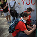 Students gathered on the Brickyard to sign a thank-you poster in appreciation of donors at the first-ever Thank You Day.