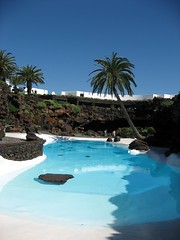 Designer Pool (8DCPhotography (www.8dcphotography.co.uk)) Tags: blue pool garden lanzarote bluesky swimmingpool palmtree canaryislands cesarmanrique jameosdelagua ixus800is andycarr
