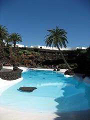 Designer Pool (8DCPhotography (www.8dcphotography.co.uk)) Tags: blue pool garden lanzarote bluesky swimmingpool palmtree canaryislands cesarmanrique jameosdelagua ixus800is andycarr
