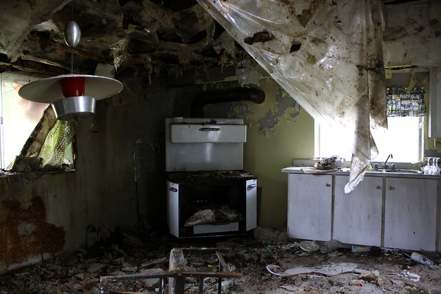 The kitchen has rotted around the dishes, which are only half done. It appears that someone just walked off halfway through doing the dishes, and never came back.
