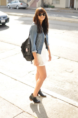 white dress with jean jacket and boots