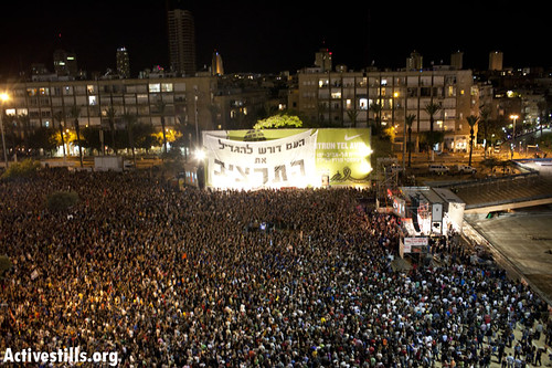 Over 20,000 gathered in Tel Avivs Rabin Square to demand social and economic justice, with many echoing refrains now heard at Occupy Wall Street protests.