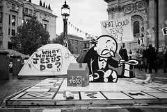 What would Jesus do? (digitalesse) Tags: camp blackandwhite london protest photojournalism documentary banksy tent monopoly stpaulscathedral cityoflondon whatwouldjesusdo olsx