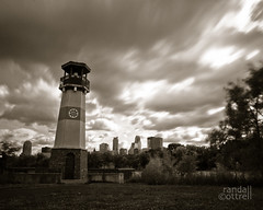Booming Through Time (Randall Cottrell) Tags: longexposure lighthouse minnesota skyline sepia clouds photography downtown cityscape afternoon minneapolis mississippiriver ndfilter 2011 boomisland weldingglass randallcottrell