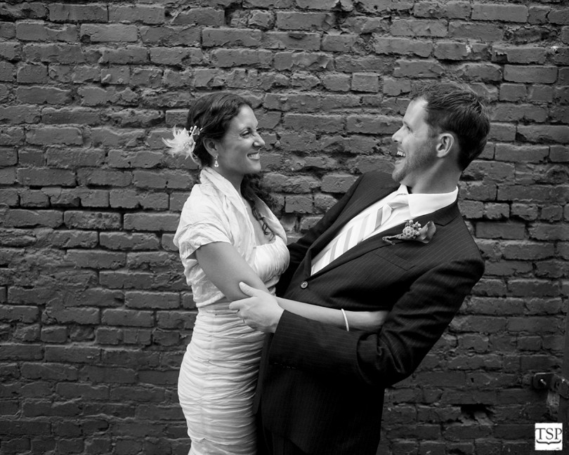 Bride and Groom Laugh Together