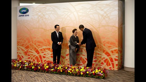 President Barack Obama is greeted by Prime Minister Naoto Kan