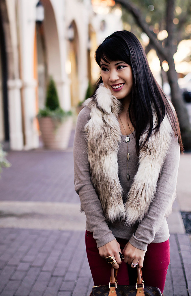 loft faux fur vest, gap taupe v-neck sweater, guess cascading necklace, louis vuitton speedy 25, sole society marco santi dash nude pumps, romwe street style gem arty ring, forever 21 red skinny pants