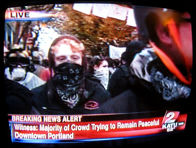 Occupy Portland: some covered faces at 4th & Main, Portland, OR, 11/13/11 about 4:25 PM on KATU