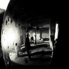 take a peek... (robert suhonen photography) Tags: bw strange dark square mirror flickrchallengewinner