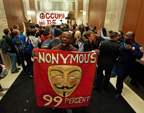 Protesters from Occupy DC, crash into the lobby of the Victor Building at 750 9th Street in Washington DC